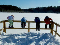 Kids looking out from overlook in winter