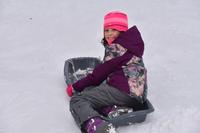 Girl sledding during February Vacation Week at Wachusett Meadow Wildlife Sanctuary