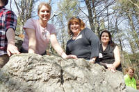 Group of teachers on a glacial boulder