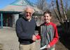 13 year old Ben Caldwell hands Bob a check for 300 dollars_reduced