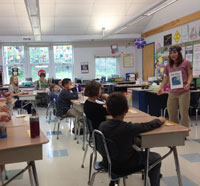 Students in the classroom with a Wellfleet Bay Wildlife Sanctury naturalist