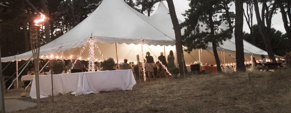 Tent during an outdoor function at Wellfleet Bay Wildlife Sanctuary