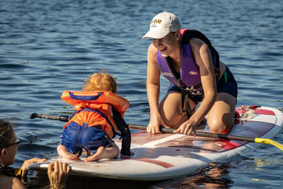 Stand-up Paddleboarding for the whole family at Wildwood's Family Camp