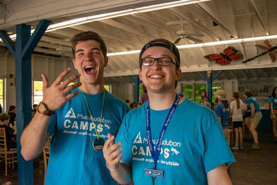 Two counselors with big smiles welcome you to Wildwood!