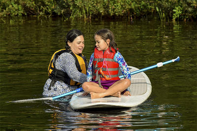 Mother and daughter trying Stand-Up Paddleboarding at Wildwood Family Camp