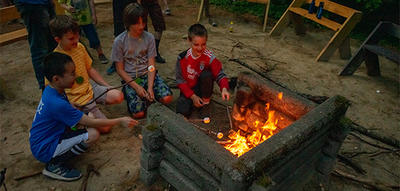 Roasting marshmallows at overnight camp