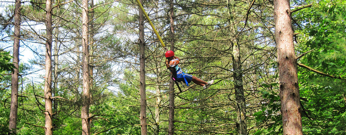 Teen camper doing the Ropes Course at Wildwood