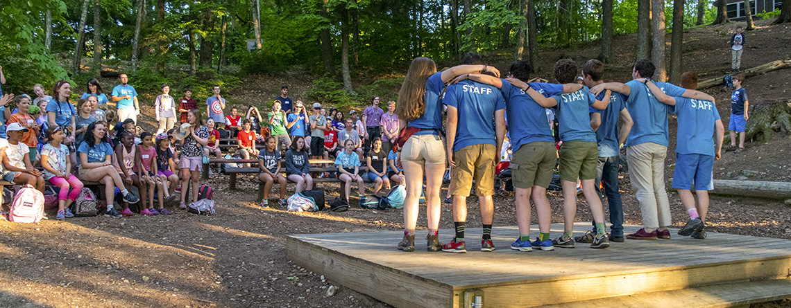 Wildwood campers gather in the amphitheater for an evening program of song and dance