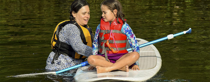 Mother & daughter doing SUP at Wildwood's Family Camp