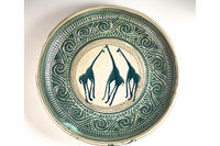Stoneware bowl with giraffe motif © Ann Schunior
