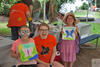 Two girls and a volunteer at Butterfly Festival © K Higgins Photography