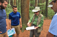 Instructor showing a trail reroute in the field at Broadmoor