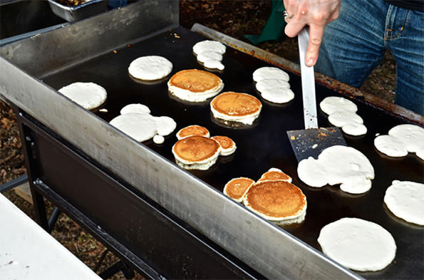 Making pancakes at Drumlin Farm's Sap-to-Syrup Farmer's Breakfast