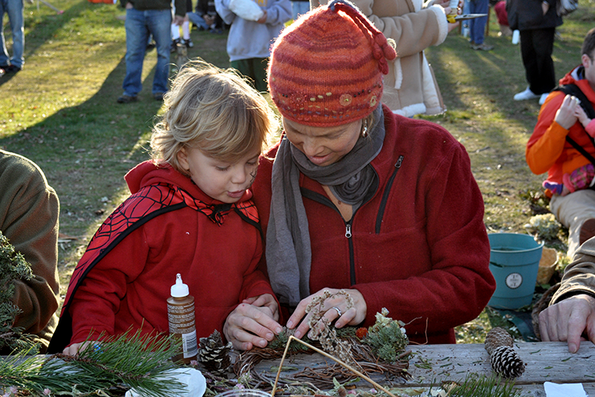 Family doing crafts at Felix Neck's Annual Fall Festival