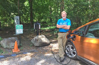 Charging a car at Habitat's EVSE