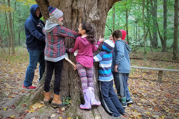 Kids hugging a big tree at Ipswich River