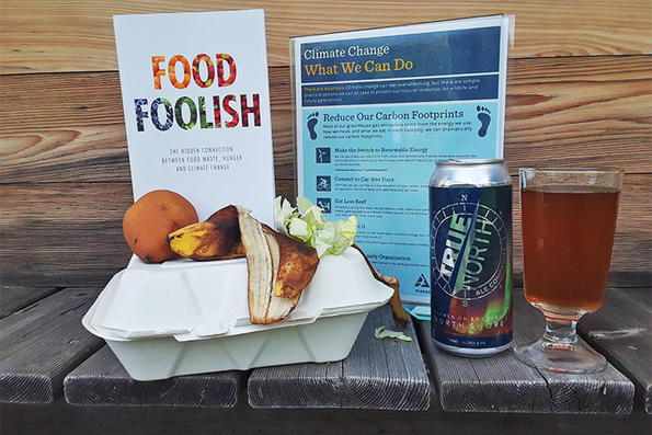 Food Foolish book, climate change sign, True North beer in a glass