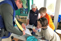 Learning bird banding science at Joppa (Photo: Melissa Vokey)