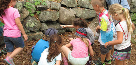 Campers examining a rock wall