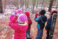 Kids using cardboard tube binoculars during Decmeber Vacation Days at Moose Hill