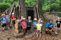Discoverers campers in the Nature Play Area at Oak Knoll Wildlife Sanctuary