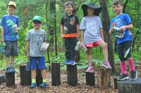 Oak Knoll campers standing on balance logs