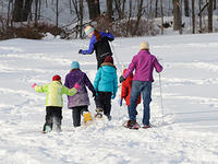 Group of kids snowshoeing at Wachusett Meadow