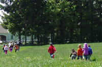 Preschoolers running through field