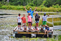 Adventurers campers on the pond dock at Wachusett Meadow Wildlife Sanctuary