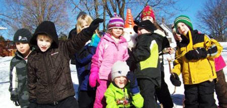 Building a snowman during February Vacation at Wachusett Meadow