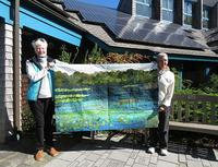 Tricia Smith (left) & wife Fran Lussier won a wall quilt sewn by Susan Goldstein