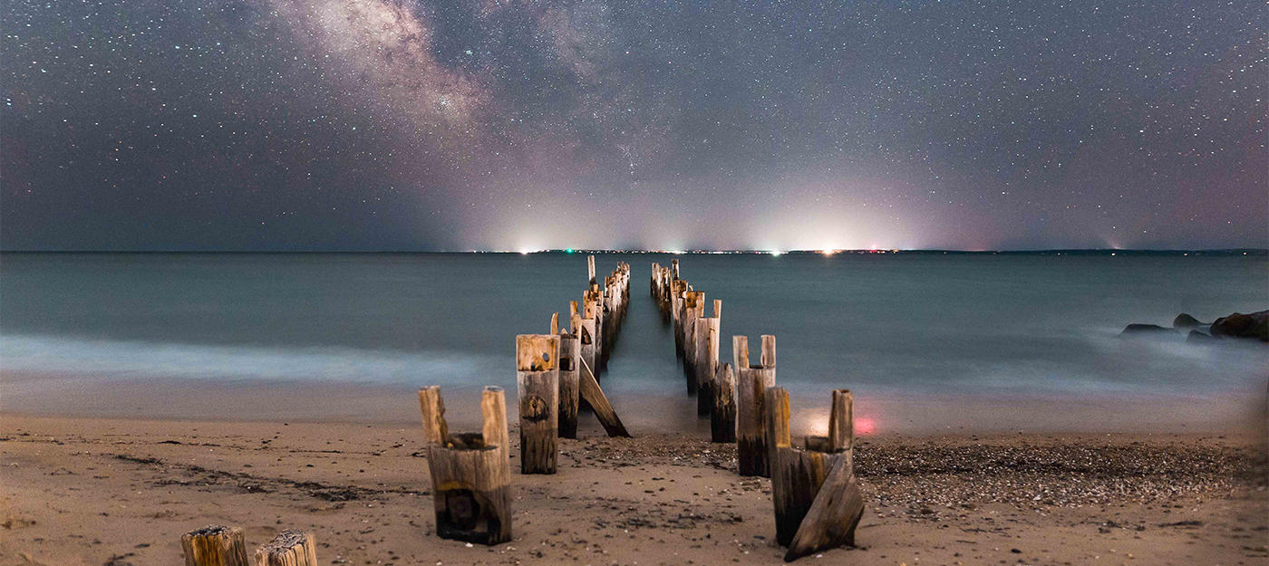 Starry sky and skyline on Falmouth beach © Evan Guarino
