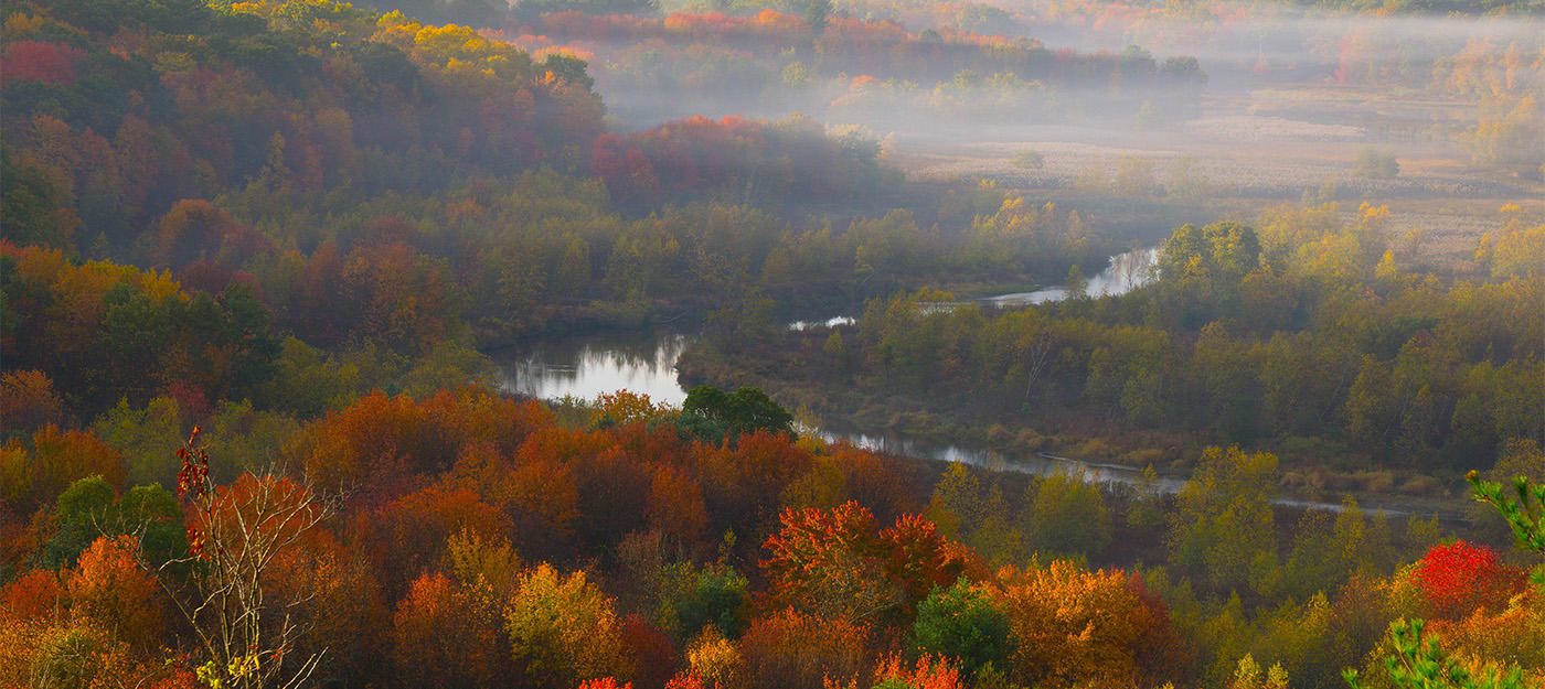 View of misty river valley in autumn © Art Donahue