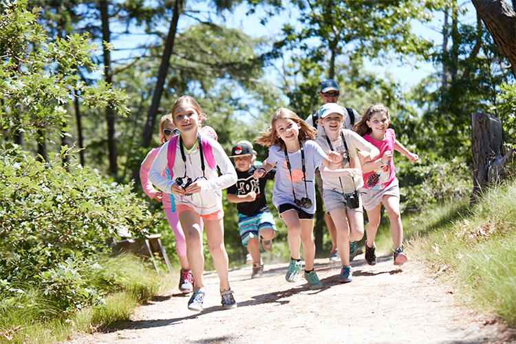 Wellfleet Bay campers running on a trail