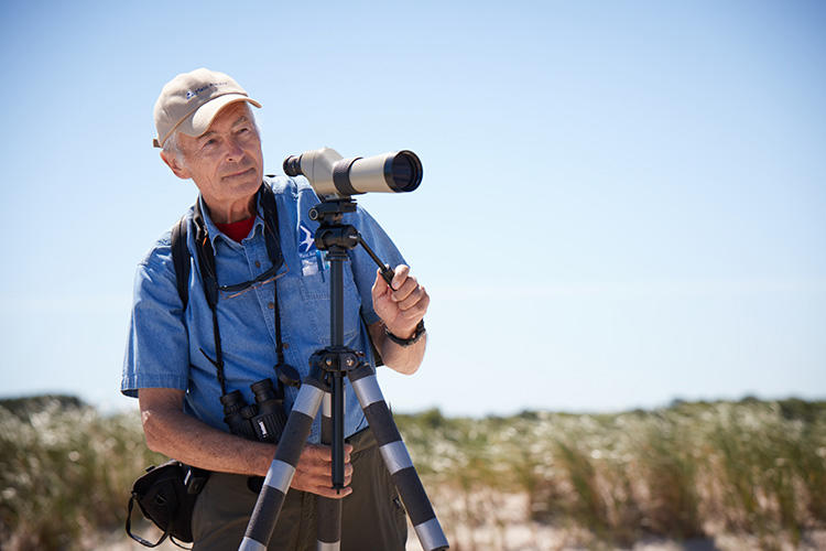 Man using scope at Wellfleet Bay Wildlife Sanctuary